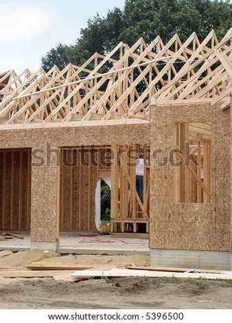 New home under construction in suburban setting - stock photo