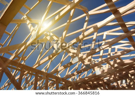 New Home Under Construction with Sunlight - stock photo