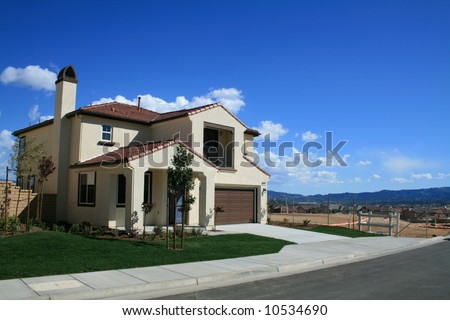 New Home with Vacant Lot Next Door - stock photo
