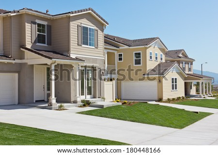 New homes built in a community up on a hill.  - stock photo