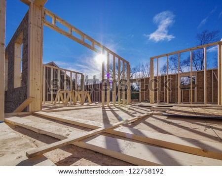 New house framing construction - stock photo