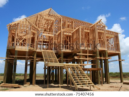 New House on Stilts under Construction - stock photo