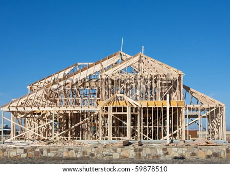 New House or Home Construction Frame with room for copy - stock photo