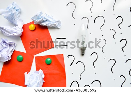new idea concept.Creative idea.Concept of  innovation.Paper crumpled and Light bulb on wooden background. Concept for success. Concept for brainstorming. Concept for solution. Concept for business. - stock photo