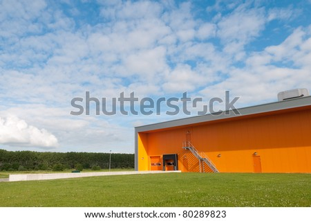 new industrial building with orange facade - stock photo