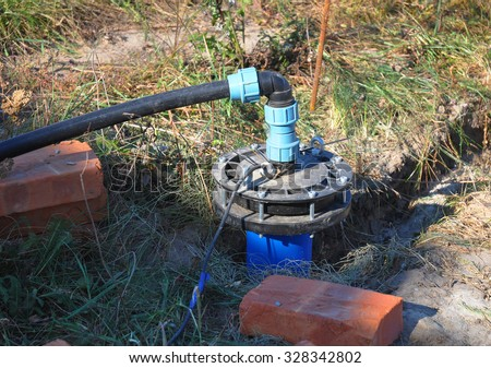 New Installed Water Bore. Pumping air from compressor into from new constructed water bore or well as process of cleaning and filtrating water. - stock photo