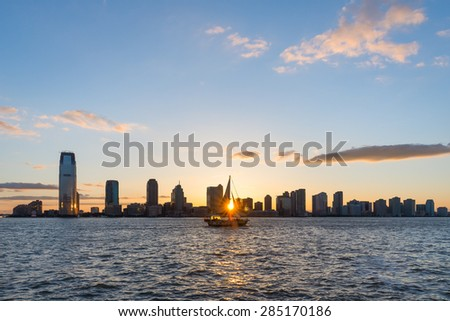 New Jersey skyline from Battery Park, New York, at sunset