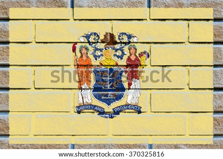 New Jersey state flag of America on brick wall - stock photo