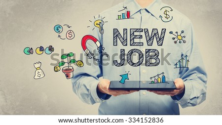 New Job concept with young man holding a tablet computer  - stock photo