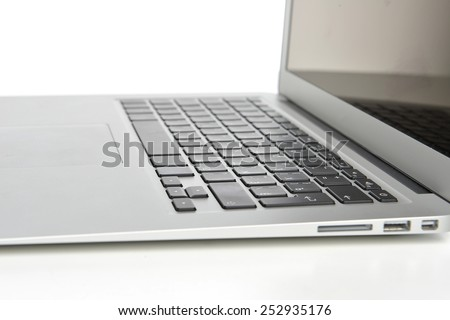 New laptop display with keyboard and  blank screen on a white background - stock photo