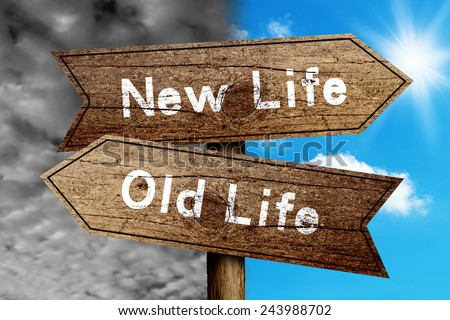 New Life Or Old Life concept road sign with cloudy and sunny sky background. - stock photo