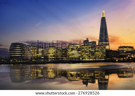 New London city hall at sunset, panoramic view from Thames river - stock photo