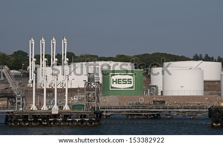 NEW LONDON,Connecticut - MARCH 20: Hess oil company fuel depot as viewed from the New London Orient Point ferry.on March 20, 2013 in New London, Connecticut, USA.