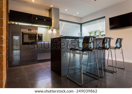 New luxury kitchen connected with dining room - stock photo