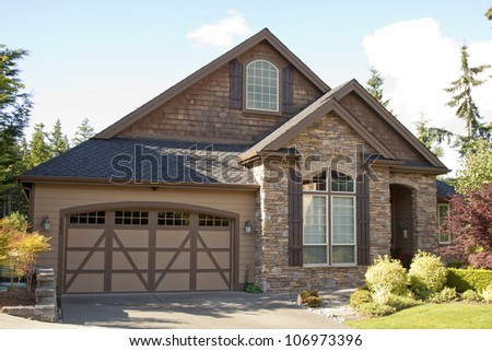 new luxury residential house on suburban street with blue sky - stock photo