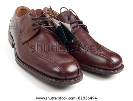New men's shoes with labels isolated on white - stock photo