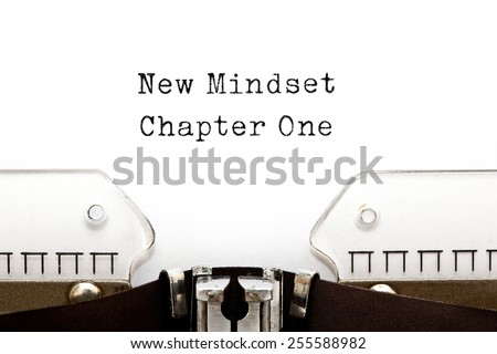 New Mindset Chapter One printed on an old typewriter. - stock photo
