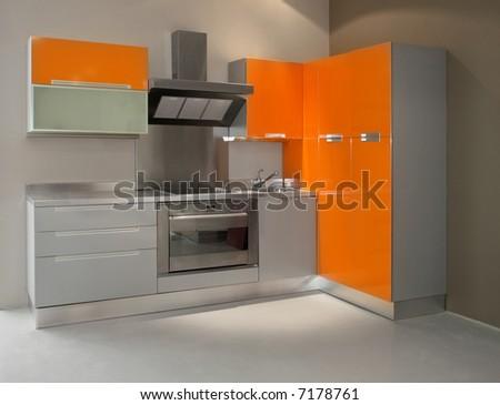 New modern kitchen in orange with metal - stock photo