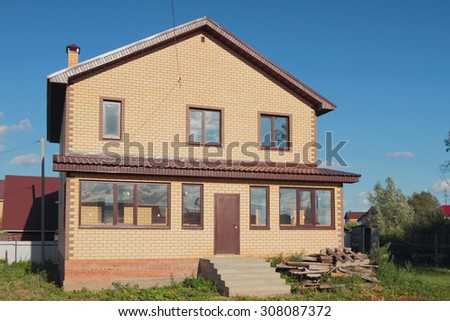 New not populated brick house in country