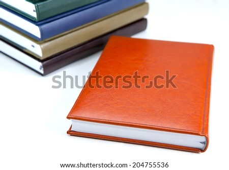 new notebook diary and some more in the back - stock photo
