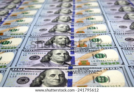 New one hundred dollar bills aligned in perspective - stock photo