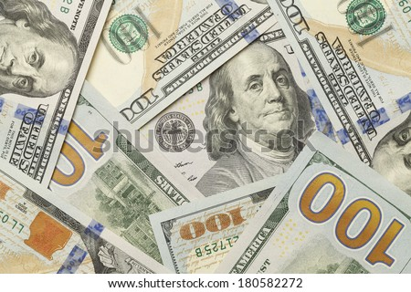 New One Hundred Dollar Bills in Scattered Pile Laying Flat. - stock photo