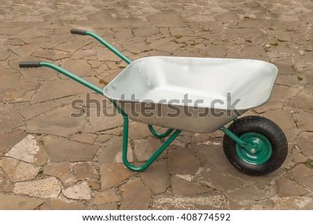 New one-wheeled wheelbarrow construction. - stock photo