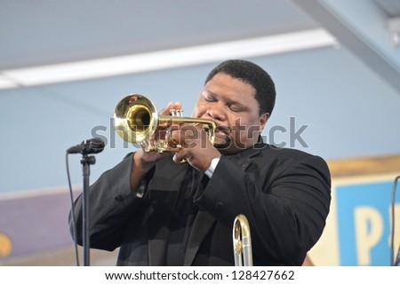 """NEW ORLEANS - CIRCA APRIL 2012: Jazz Legend Wycliffe Gordon plays a selection from his """"Hello Pops"""" Louis Armstrong tribute album at the 2012 New Orleans Jazz & Heritage Festival circa April 2012 in New Orleans - stock photo"""