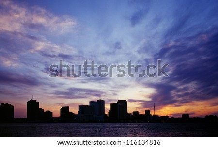 New Orleans city skyline silhouetted against a blue sunset - stock photo