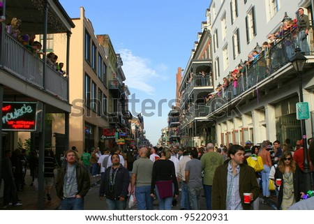NEW ORLEANS - FEBRUARY 2: People celebrated Mardi Gras parade in French Quarter. February 2, 2008 in New Orleans, Louisiana. - stock photo