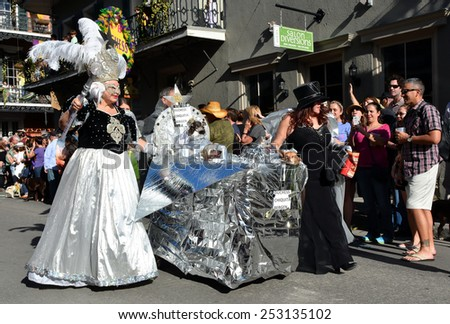 NEW ORLEANS, LA.-FEB. 8:  The Mystic Krewe Of Barkus parades through the New Orleans French Quarter on February 8, 2015.  Barkus is a Mardi Gras parade dedicated to dogs, pups and their owners. - stock photo