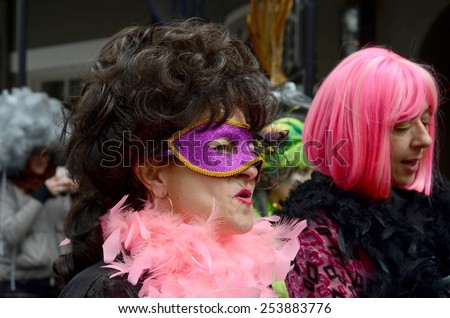 NEW ORLEANS, LA.-FEBRUARY 17:   Masqueraders parade through the New Orleans French Quarter on Mardi Gras Day, Tuesday, February 17, 2015. - stock photo