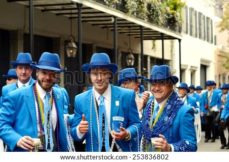 NEW ORLEANS, LA-FEBRUARY 17:  Members of Pete Fountain's Half Fast Walking Club parade through the streets of the New Orleans French Quarter on Mardi Gras Day, Tuesday, February 17, 2015.   - stock photo