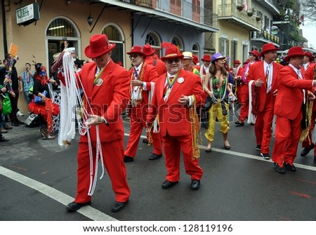 NEW ORLEANS, LA.-FEBRUARY 12:  Pete Fountain's Half Fast Marching Club parades on Bourbon Street in the New Orleans French Quarter on February 12, 2013, celebrating Mardi Gras Day. - stock photo