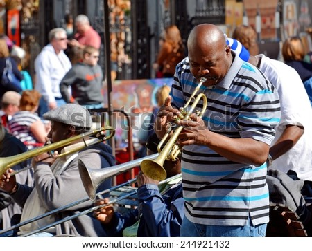 NEW ORLEANS, LA-JAN. 17: A local jazz musician performs in front of Jackson Square in the New Orleans French Quarter on January 17, 2015, to the delight of visitors in town for Mardi Gras. - stock photo