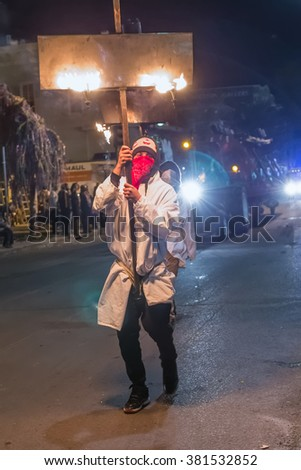 New Orleans, LA/USA - circa February 2016: Man carrying candles and fire during Mardi Gras parade in New Orleans, Louisiana - stock photo