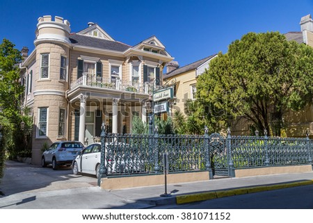 New Orleans, LA/USA - circa February 2016: Old Colonial House at the Streets of French Quarter decorated for Mardi Gras in New Orleans, Louisiana - stock photo