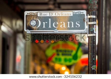 NEW ORLEANS, LOUISIANA - AUGUST 25: Orleans street sign with Pubs and bars  in the French Quarter, downtown New Orleans on August 25, 2015. - stock photo