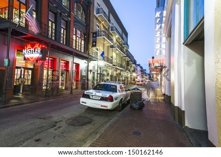 NEW ORLEANS, LOUISIANA - JULY 14: Neon lights in the French Quarter on July 14, 2013. Tourism provides a much needed source of revenue after the 2005 devastation of Hurricane Katrina. - stock photo