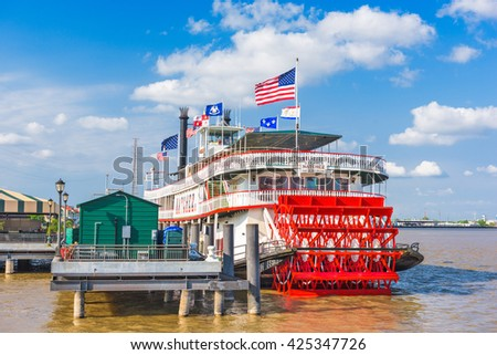 NEW ORLEANS, LOUISIANA - MAY 10, 2016: The steamboat Natchez on the Mississippi River. - stock photo