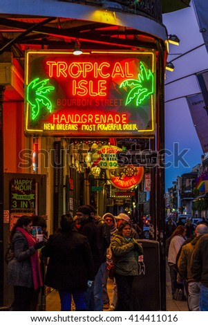 NEW ORLEANS, LOUISIANA USA- FEB 2 2016: Pubs and Bars having colorful lights and decorations in the French Quarter. Tourism provides a much needed financial source, also home for great musicians.