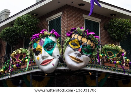NEW ORLEANS, LOUISIANA,USA - FEBRUARY 8: Brightly colored masks adorn a railing in the French Quarter as Mardi Gras approaches in New Orleans on February 8, 2013. - stock photo