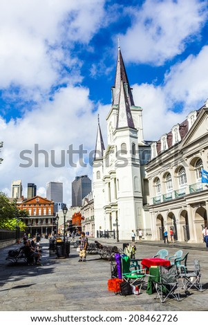 NEW ORLEANS, LOUISIANA USA - JULY 17, 2013:  St. Louis cathedral in the French Quarter in New Orleans, USA. Tourism provides a large source of revenue after the 2005 devastation of Hurricane Katrina. - stock photo