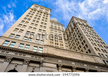 NEW ORLEANS, LOUISIANA USA - MAY 4,2014: The historic Hibernia National Bank building, completed in 1921, located on Gravier Street in the central business district in New Orleans, Louisiana. - stock photo