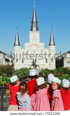 NEW ORLEANS, OCTOBER 15: Unidentified children from a local school visit Jackson Square near St. Louis Cathedral in New Orleans, LA on October 15, 2010. - stock photo