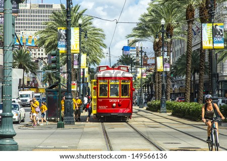 NEW ORLEANS, USA - JULY 17: New Orleans Streetcar Line, July 17, 2013. Newly revamped after Hurricane Katrina in 2005, the New Orleans Streetcar line began electric operation in 1893. - stock photo