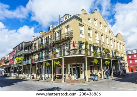 NEW ORLEANS, USA - JULY 17, 2013: people visit historic building in the French Quarter in New Orleans, USA. Tourism provides a large source of revenue after the 2005 devastation of Hurricane Katrina. - stock photo