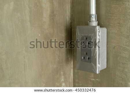 new outlet and steel pipe electric wire on loft style wall  - stock photo
