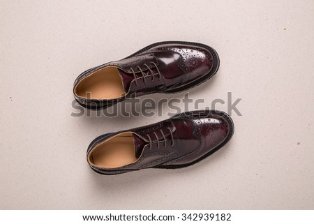 New pair of man brogues shoes on a gray background. - stock photo
