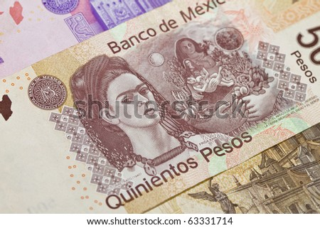 New 500 peso mexican bill closeup showing Frida Kahlo the painter. This is the newest bill as of 2010 on the Mexican currency. Other bills above and below.